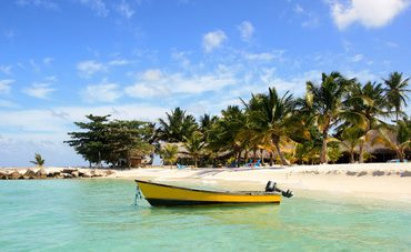 Boat at the beach of Bayahibe